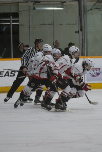 Cariboo Cougars celebrate their first goal in the quarter final of the Mac's AAA Midget tournament © J. Ashley Nixon