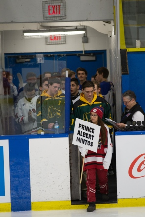 © J. Ashley Nixon Mac's Midget teams led onto the ice at Max Bell Arena, Calgary