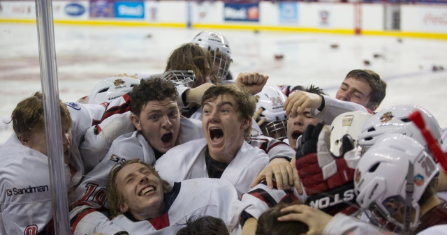 Cariboo Cougars players celebrate their winning goal in overtime. © J. Ashley Nixon