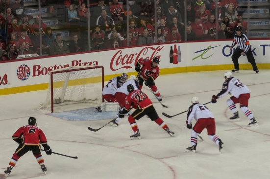Jiri Hudler passes to Sean Monahan to score on the power play © J. Ashley Nixon