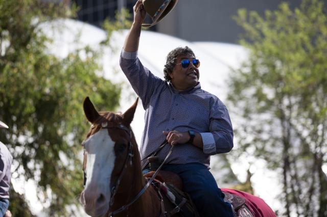 Calgary Mayor Naheed Nenshi riding in the Stampede Parade © J. Ashley Nixon