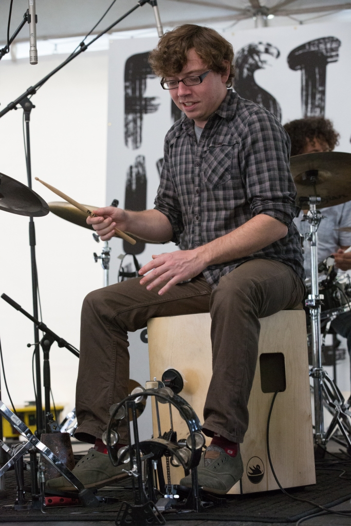 Jordan Ellis playing Cajon © J. Ashley Nixon