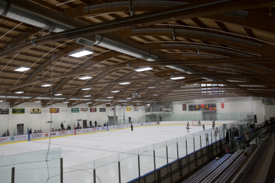 Curved roof beams were rescued from the old curling rink © J. Ashley Nixon