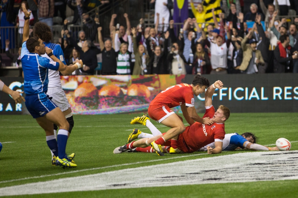 Nathan Hirayama celebrates with John Moonshine as he goes over the line for Canada's winning try in the Bowl Final versus France. © J. Ashley Nixon