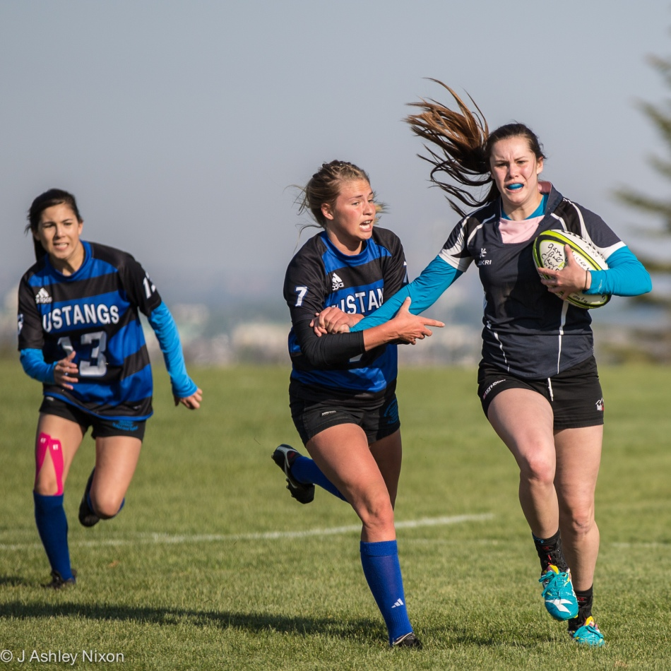 Senior Girls rugby action between Highwood HS Mustangs and F.P. Walshe HS, Fort Macleod. © J. Ashley Nixon