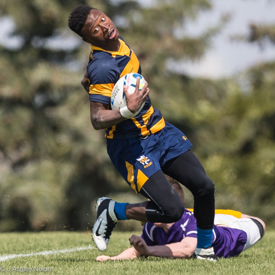 Try scored! Rugby action at Calgary Rugby Union at the Clearwater Cup between Ernest Manning High School Griffins and Lester B. Pearson High School. © J. Ashley Nixon