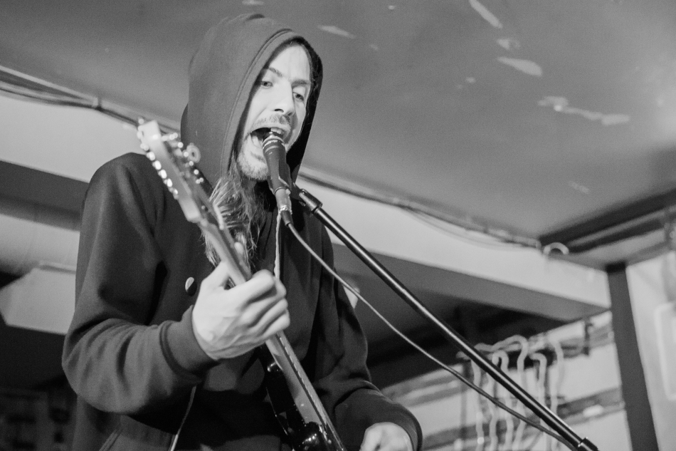 Andy March, vocalist with Crosss sings out from under the hood at The Palomino during the Sled Island Music Festival, Calgary, 2016 © J. Ashley Nixon