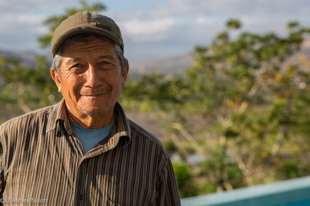 Manuel by his chacra (small-holding) and the swimming pool at Hotel Urqu, Jaén, Peru. © J. Ashley Nixon