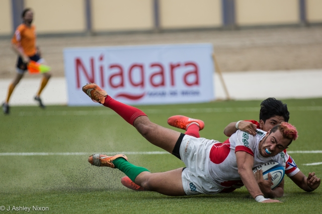 Mexico U18 centre #12 tackled just in front of the try line in the international game versus Venezuela in Chiclayo, Lambayeque, Peru © J. Ashley Nixon