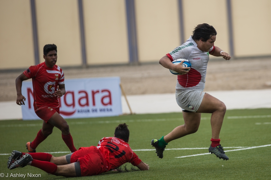A Mexico U18 Serpents forward evades a last gasp tackle to score a try in the international game versus Peru in Chiclayo, Lambayeque, Peru © J. Ashley Nixon