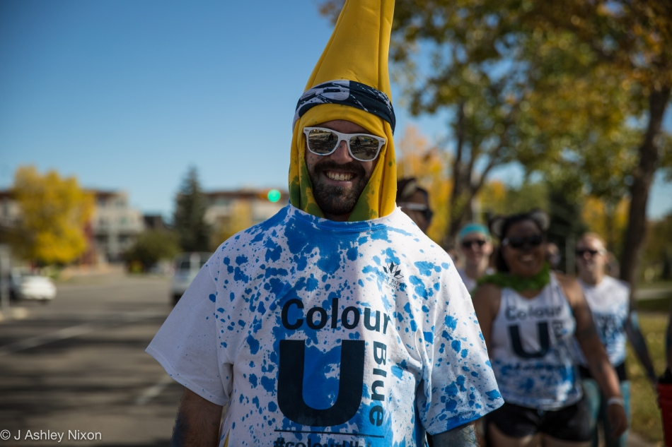 Anthropologist Alex turns bananas at the #colourUblue event at Mount Royal University, Calgary, Canada. © J. Ashley Nixon