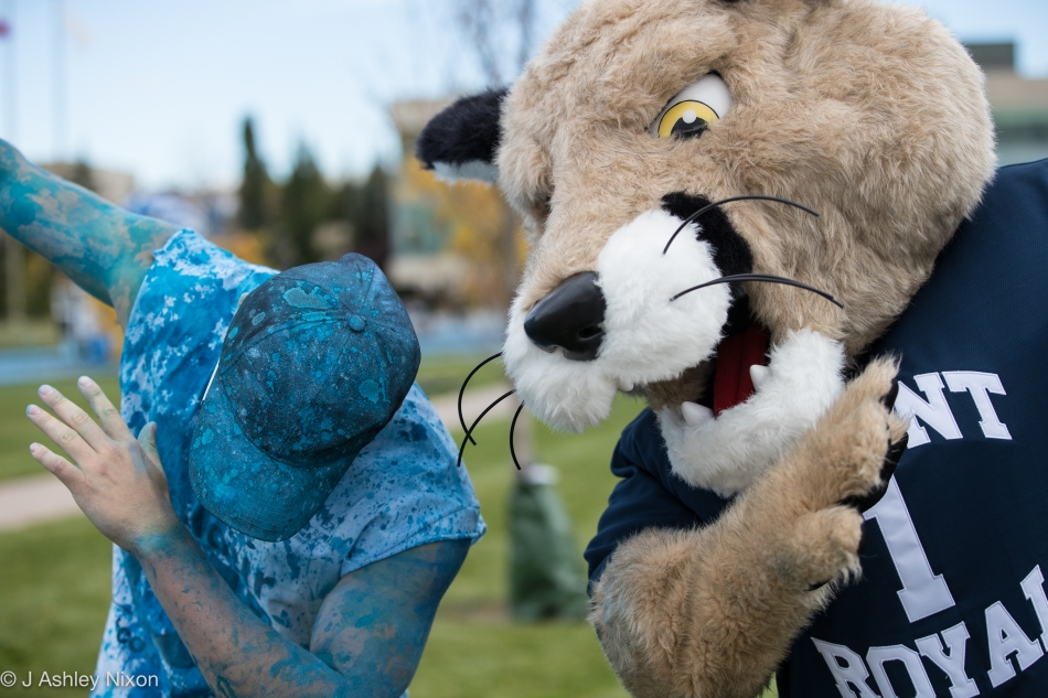 Who leads? Student and Cougar take up dancing at the #colourUblue event, Mount Royal University, Calgary, Canada. © J. Ashley Nixon