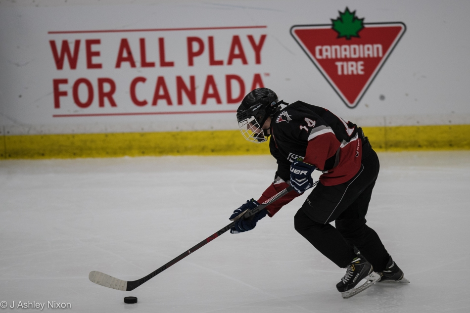 Action from the Bantam 1-B Final: Calgary Girls Hockey White Hawks versus Saskatoon Comet Impact at the Canadian Tire Wickenheiser World Female Hockey Festival, WinSport Arenas, Calgary, Canada © J. Ashley Nixon