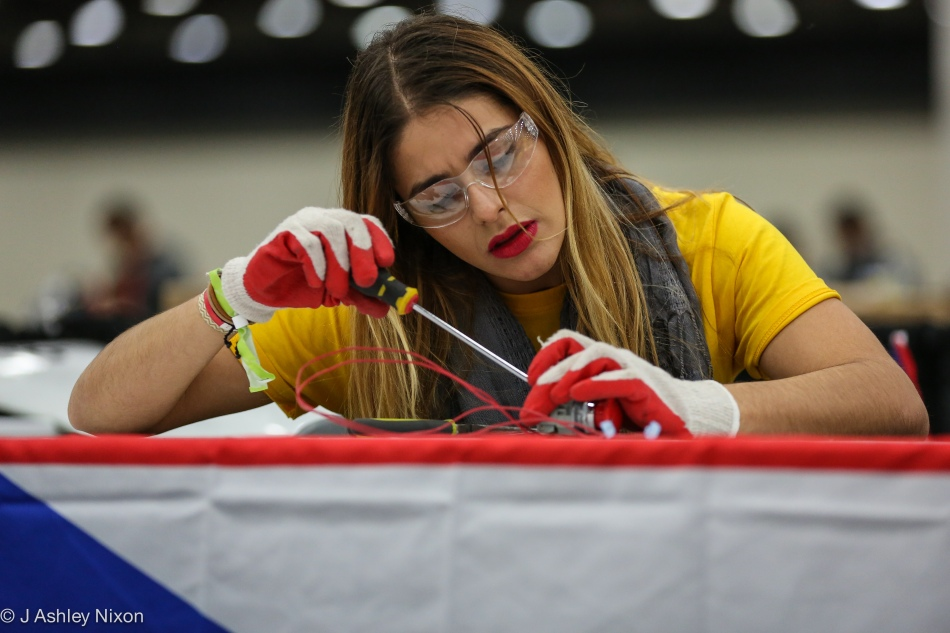 An engineering student from the Inter-America University of Puerto Rico preparing her team's vehicle for the Shell 2016 Americas Eco-marathon in the Cobo Center, Detroit, USA