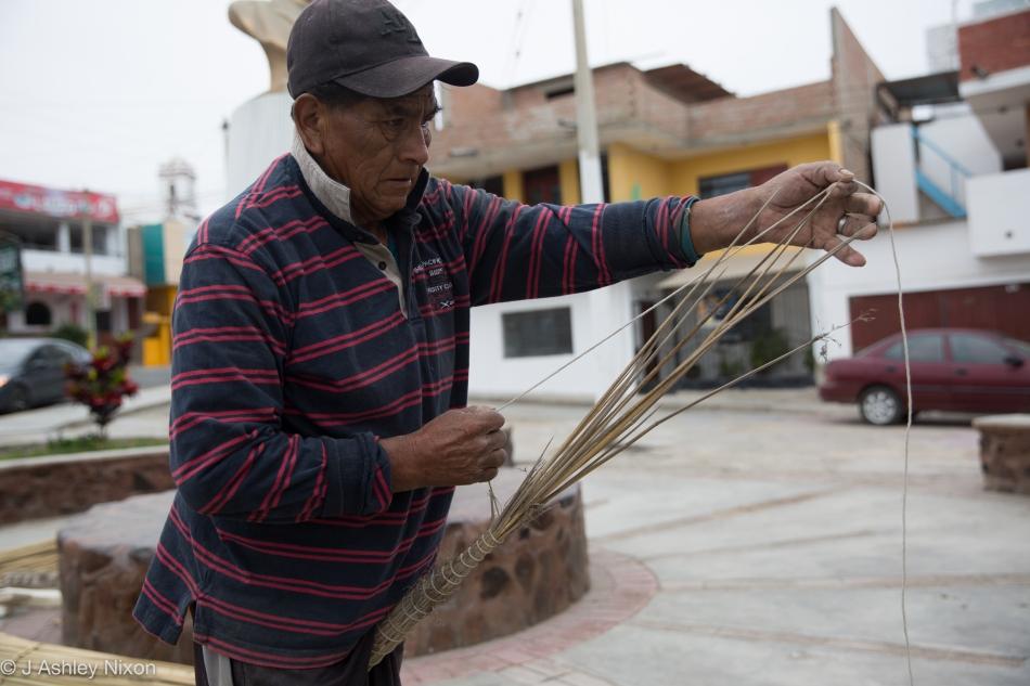 José constructs a reed fishing boat, Caballito de Tora in Huanchaco, Peru. © J. Ashley Nixon