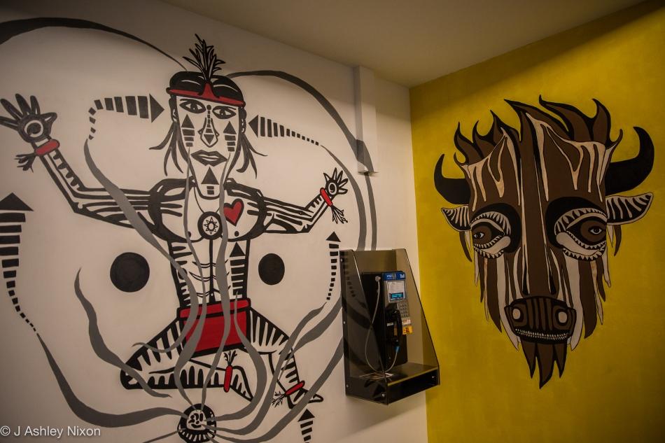 Sundancer and Buffalo. Two wall paintings by Indigenous (Blackfoot) artist, Ryan Jason Allen Willert HeavyShield, at Mount Royal University, Calgary, Canada. © J. Ashley Nixon