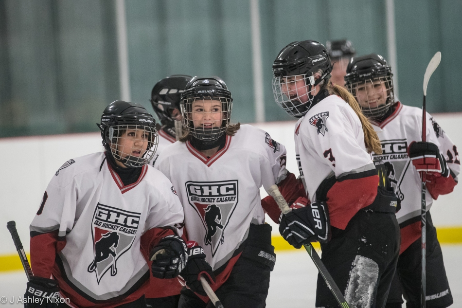 Calgary Girls Hockey Bantam 1 (White Hawks) celebrate a goal in a tournament at Canal Flats, BC, Canada. © J. Ashley Nixon