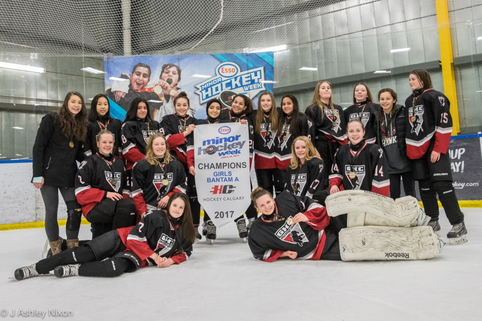 Calgary Girls Hockey White Hawks celebrate their win in the Girls Bantam 1 Final at Max Bell Arena in the Esso Minor Hockey Week tournament, Calgary, Alberta, Canada. © J. Ashley Nixon