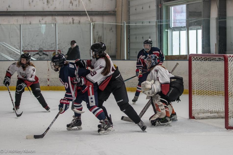 Action between Calgary Girls Hockey Bantam 1 and Coeur D'Alene Hockey Academy at the Northern Rockies Classic in Missoula, Montana, USA © J. Ashley Nixon