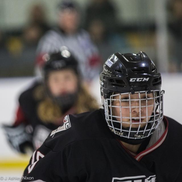 Headshot: Calgary Girls Hockey defenseman in action against Olds Grizzlies © J. Ashley Nixon