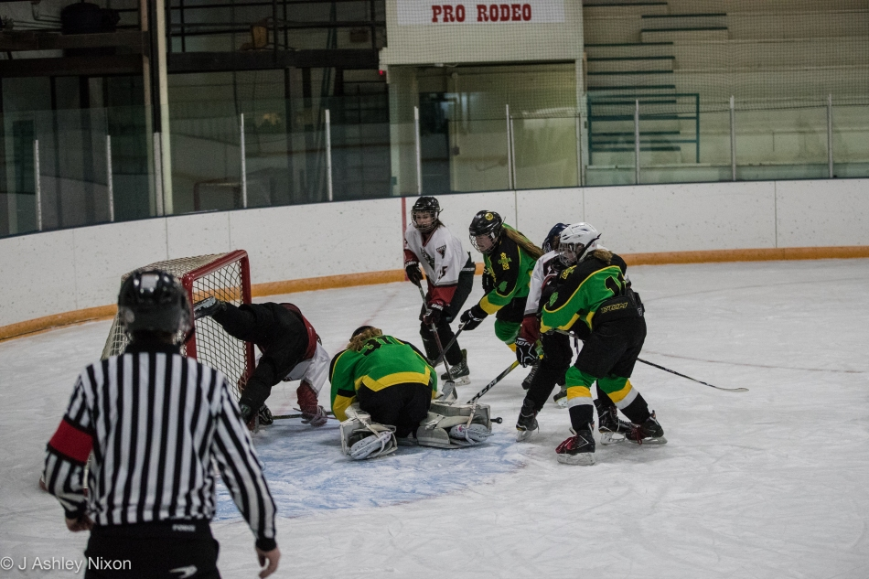 Hockey tumble in Stavely, home of Canada's First Indoor Rodeo. Calgary Girls Hockey Bantam 1 White Hawks came out winners against Okotoks. © J. Ashley Nixon