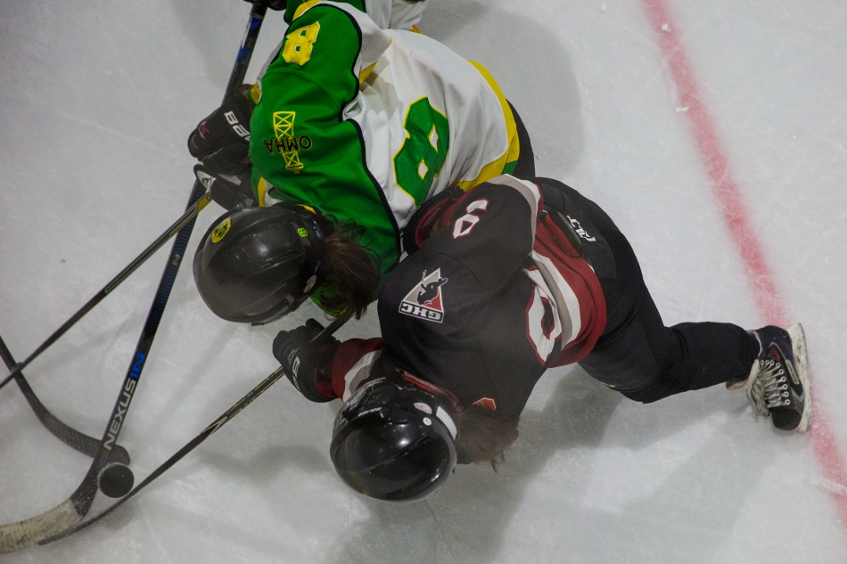 Action from Okotoks Oilers versus Calgary Girls Hockey White Hawks at the Scott Seaman Sports Rink, Millarville, Alberta, Canada. © J. Ashley Nixon