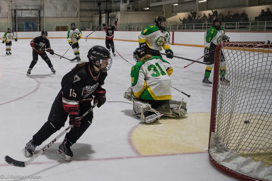 Centre Maddy Noonan scores her second goal for the Calgary Girls Hockey Bantam White Hawks against the Okotoks Oilers in the first round of the Calgary City hockey championships in Black Diamond, Alberta, Canada. © J. Ashley Nixon