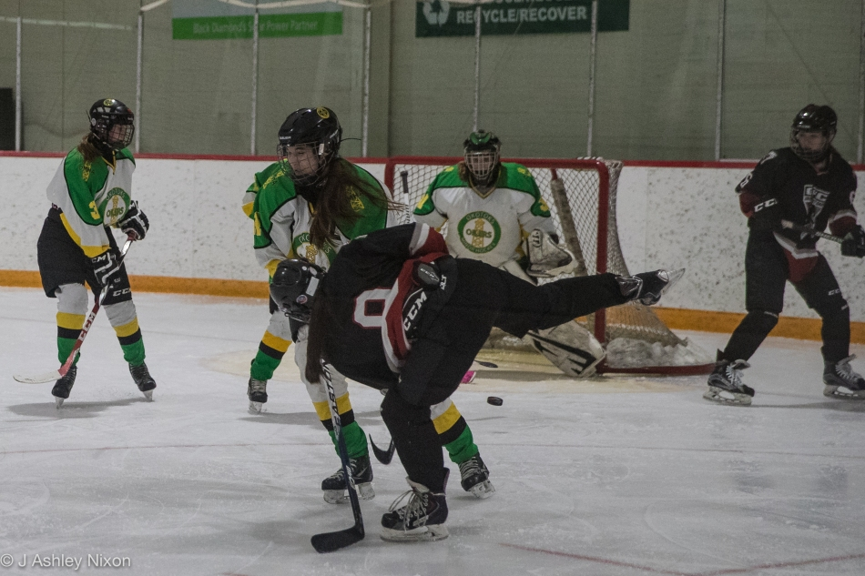 Action from the Calgary City Bantam Girls hockey championships, first round game between Okotoks Oilers and Calgary White Hawks in Black Diamond, Alberta, Canada. © J. Ashley Nixon